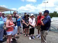 "On board the USS Missouri ""Mighty Mo"" where World War II (Pacific) ended. Tour Guide J Ford Murray memorizes visitors as he skillfully recounts the historic surrender."